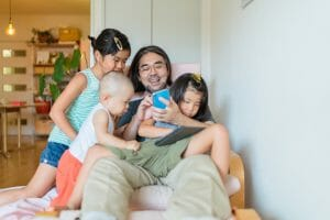 Happy single dad with children after divorce Robin Graine Divorce Coach
