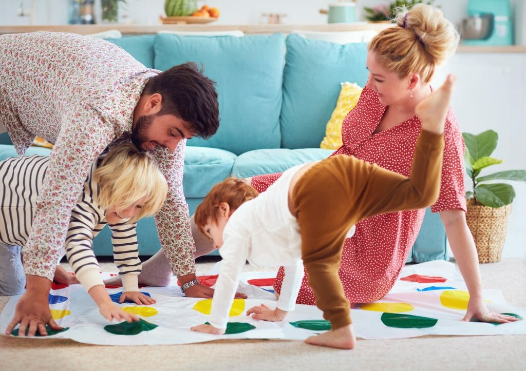 Family playing a twister game.