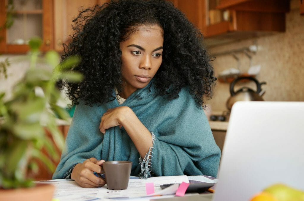 Woman reviewing her finances before doing a DIY divorce